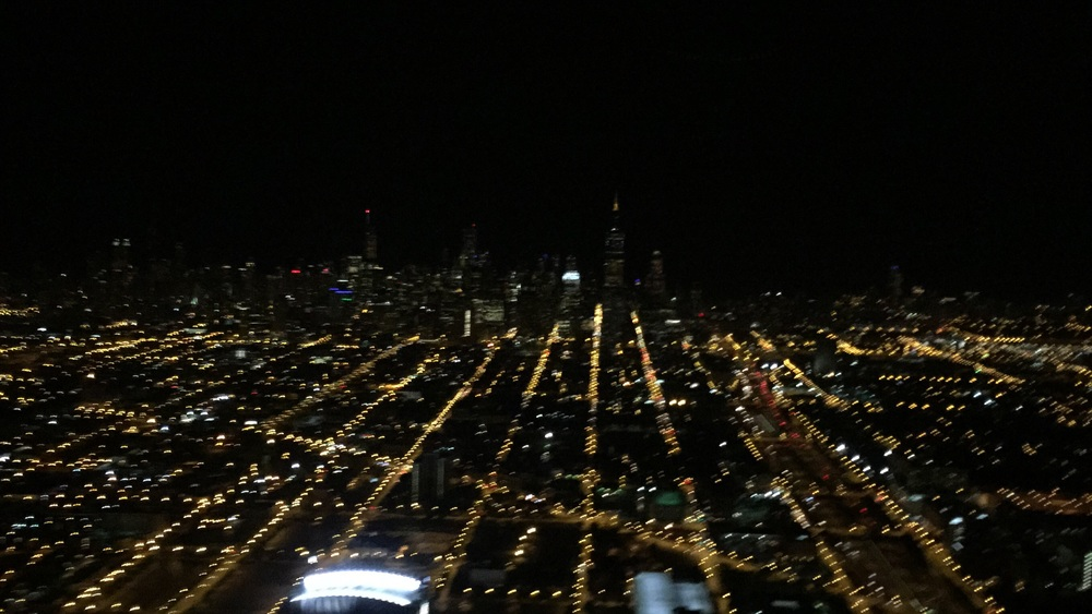 Flying over Chicago late at night. We we riding a glass chopper care of Rotorzen and Adrenaline360