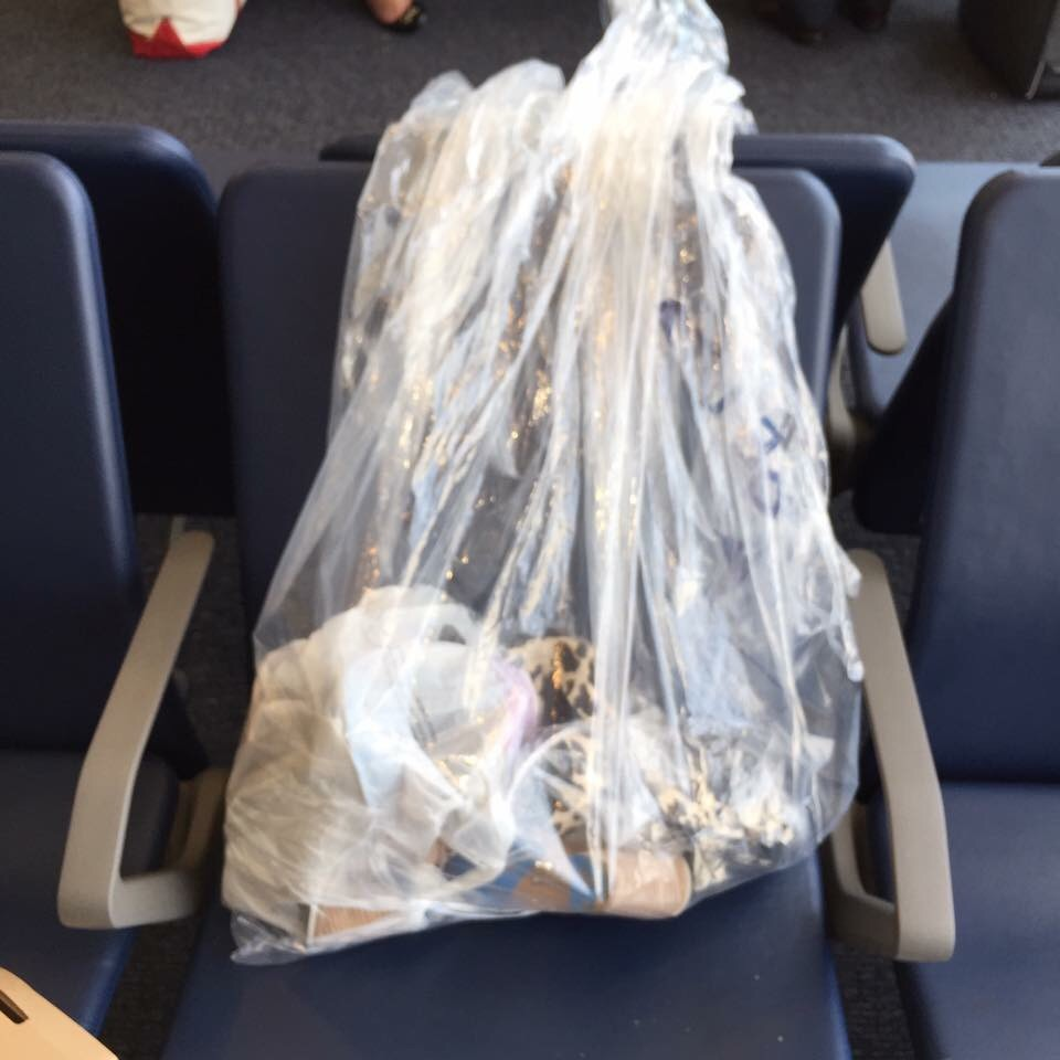 My overweight items that were transfered to a clear garbage bag. I had to carry it everywhere in the airport.