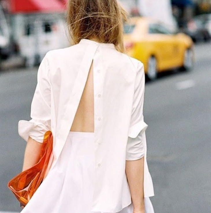 Wearing man's shirt with an A-Line midi skirt. You may just button the collar version for a sneak peak of your back