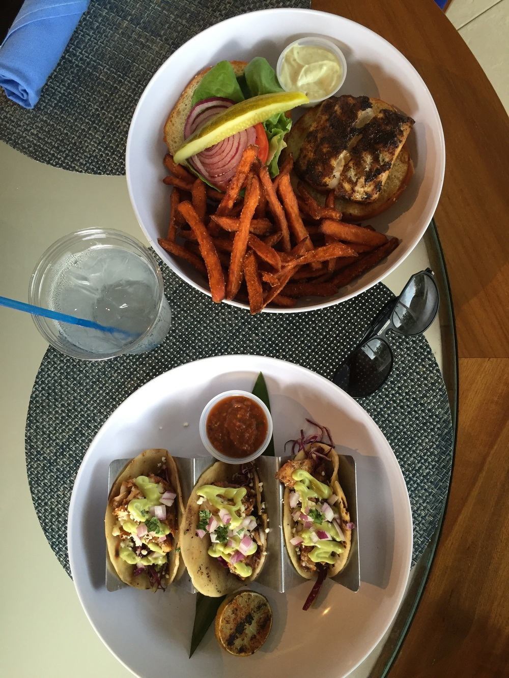 Fish tacos and blackened fishburger with a side of sweet potato fries.