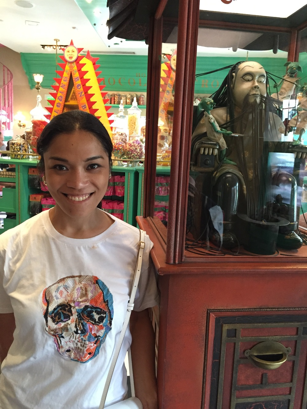 Zonko's Toy shop with my Pride-inspired Death Eater shirt.