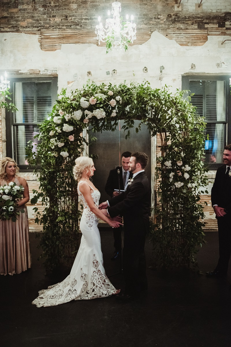 wedding arch, wild smilax vine on arch, greenery chandelier, aria minneapolis, studio fleurette.jpg