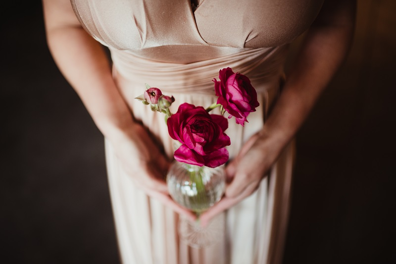 plum ranunculus, burgundy flowers, studio fleurette, champagne bridesmaid dress, glass bud vase.jpg