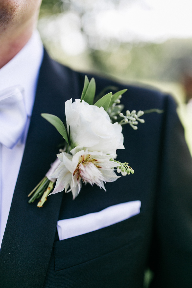 blushing bride protea boutonniere, studio fleurette, rustic blush boutonniere.jpg