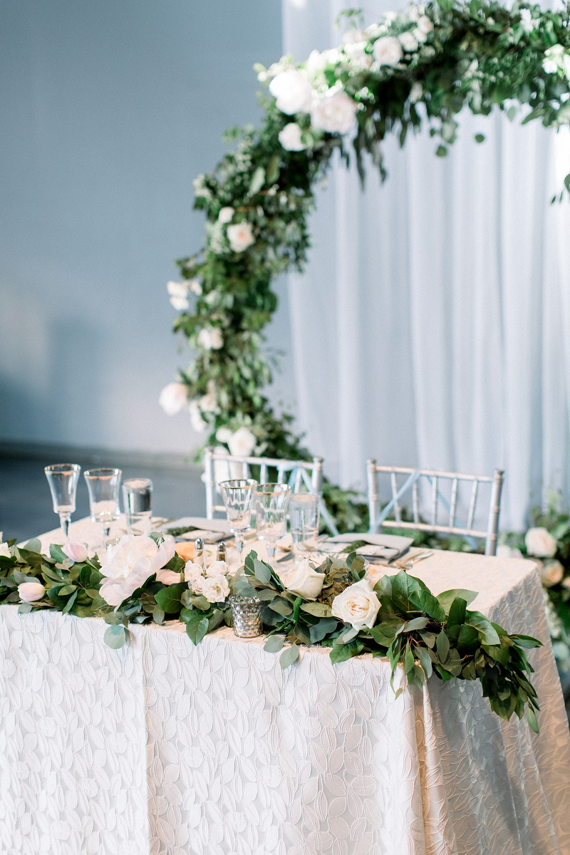 romantic minneapolis wedding, studio fleurette, sweetheart table floral garland, wedding ceremony floral installation, floral ring backdrop.jpg
