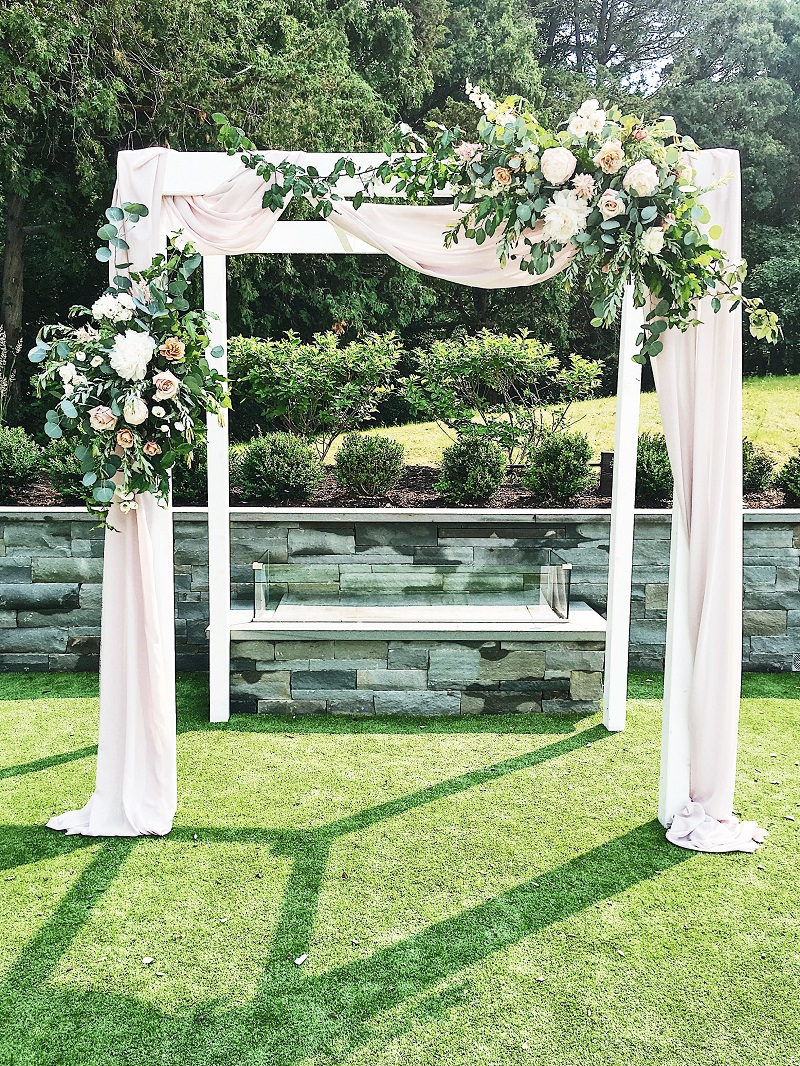 blush fabric on arch, hutton house arch, hutton house outside ceremony, hutto house courtyard wedding, studio fleurette, floral arch.jpg