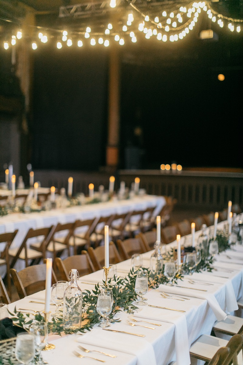 cafe lights at wedding receptions, studio fleurette, urban wedding venue wisconsin, greenery on tables.jpg