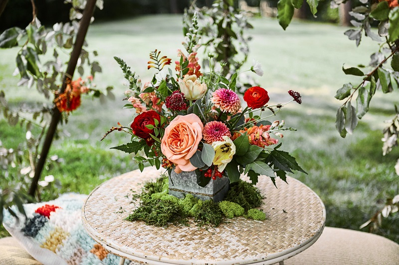 boho metal vase, moss with flowers, bohemian floral centerpiece, mn wedding florist.jpg