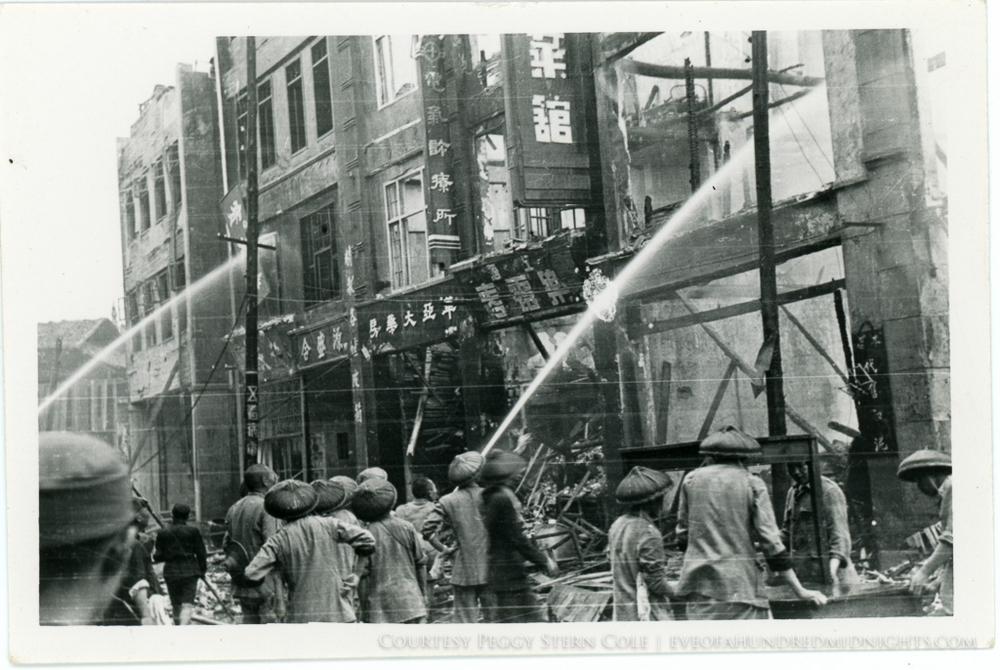 Dousing flames on Chungking building facade.jpg
