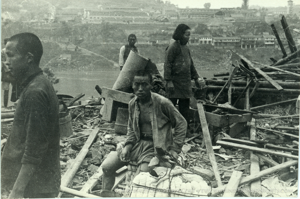 Man With Shirt Open as people scour through rubble.jpg