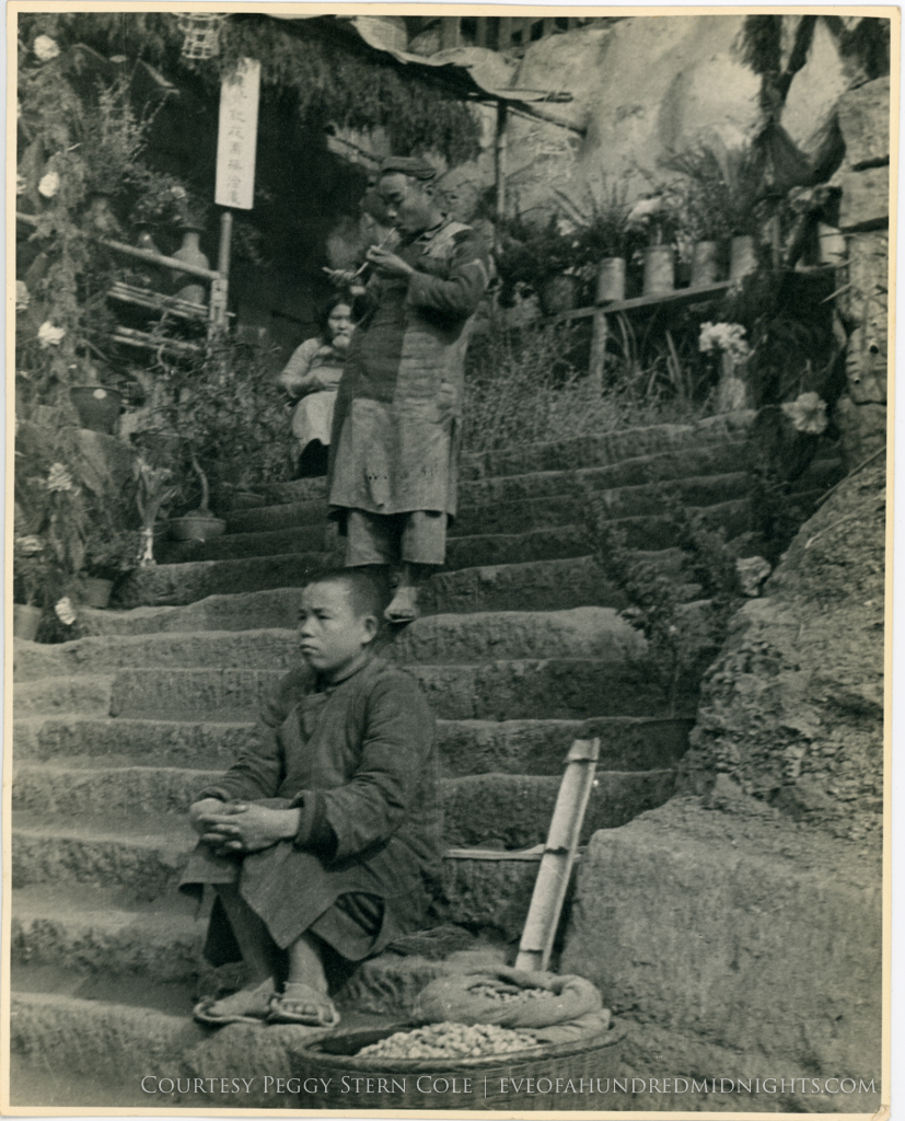 Boy by peanuts and opium smoker on steps from large print.jpg