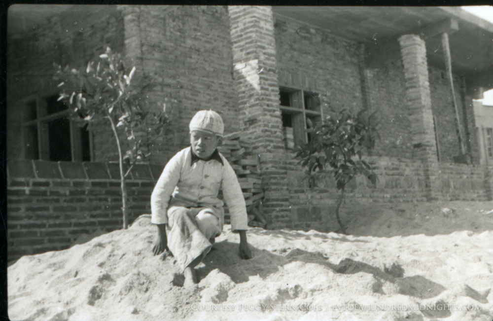 Chinese boy on dirt pile.jpg