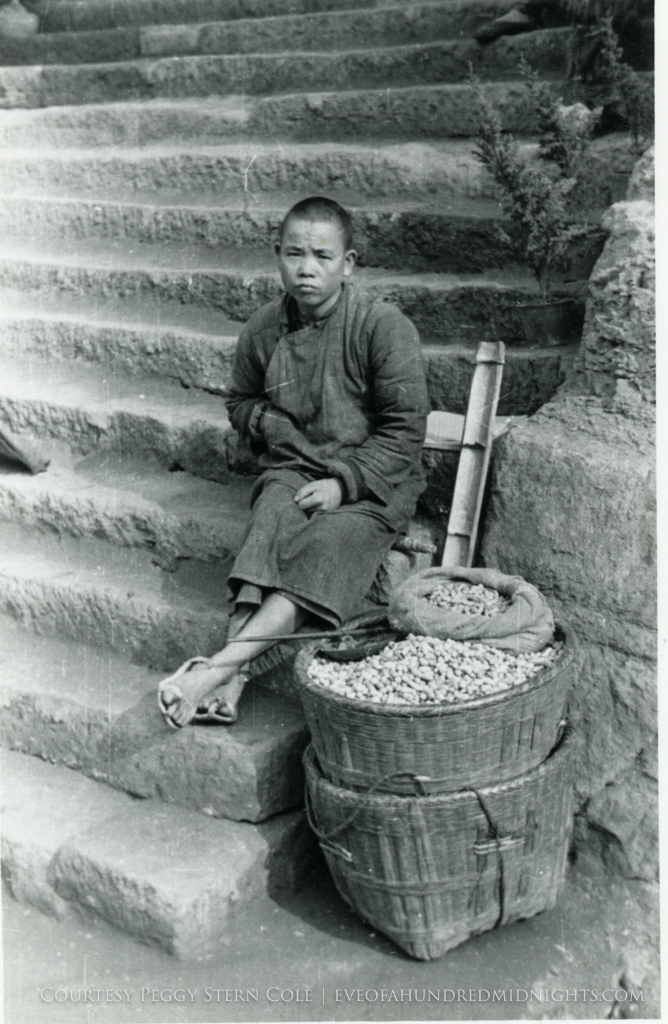 Chungking Peanut Vendor Boy on Stairs.jpg