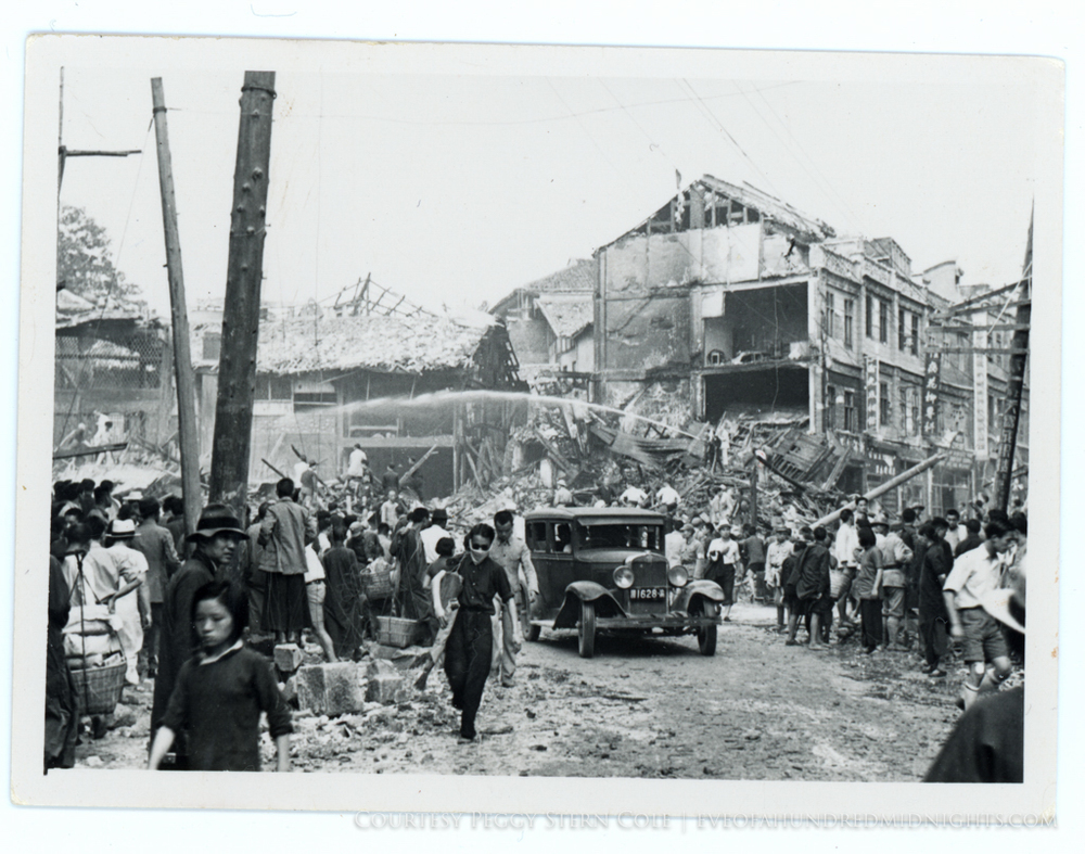 Collapsed Chungking Building after bombing With Crowd Scene and Hoses.jpg