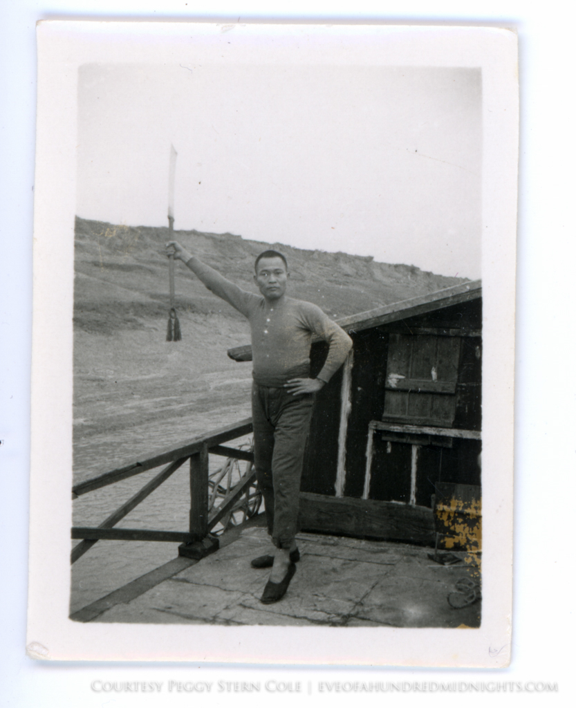 Man With Bladed Weapon on Boat Deck.jpg