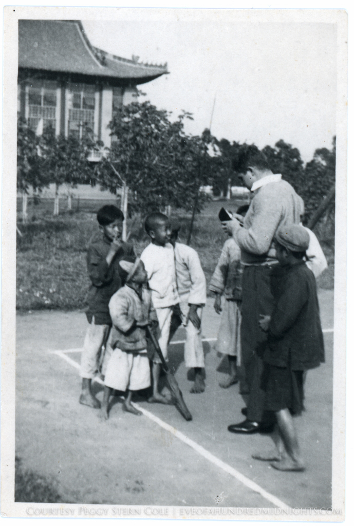 Student buying racket from kids at Lingnan.jpg
