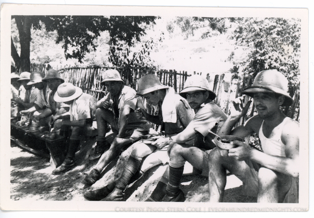 French Soldiers in line sitting and eating.jpg