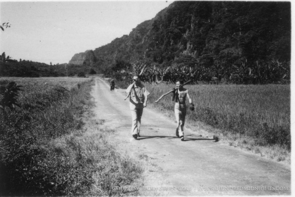 Men Carrying Logs near Indochina Bridge.jpg