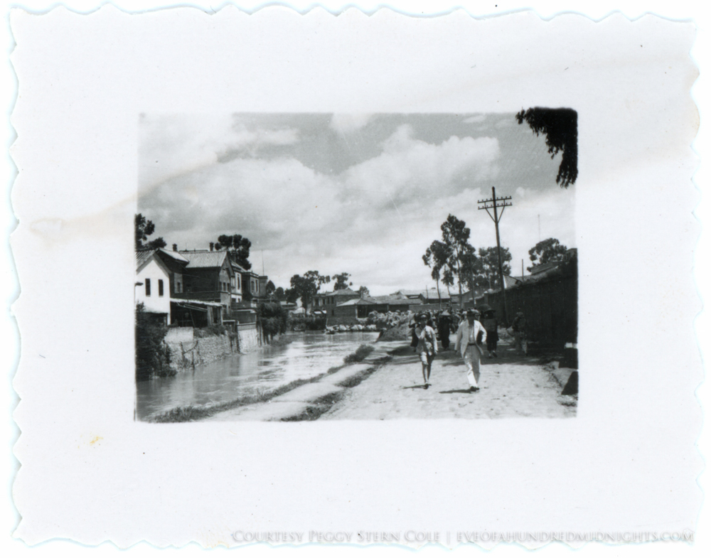 Men on Canal in likely indochina from tiny deckle print.jpg