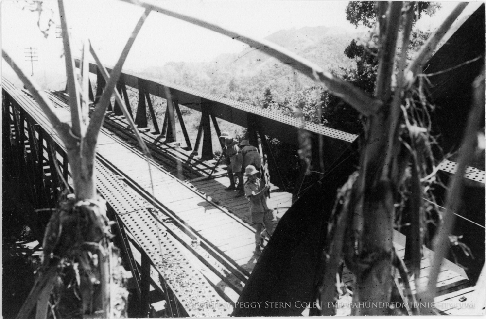 Men working on Indochina Bridge From Above.jpg