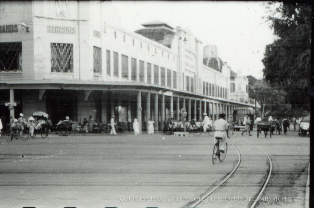 Streetcar tracks and bikes in front of Grands Magasins Hanoi from negative.jpg