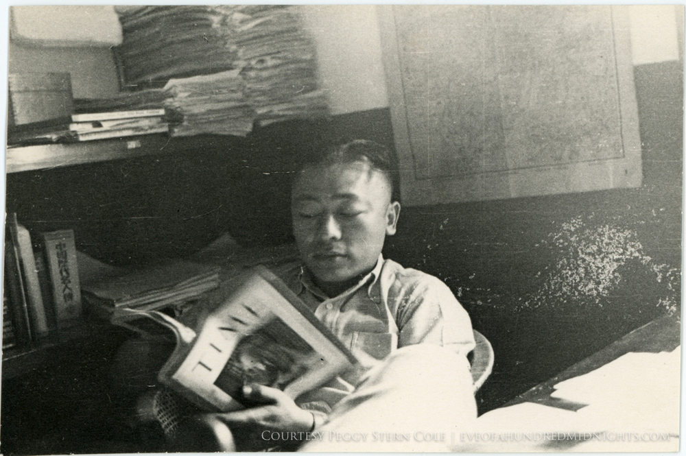 Man in Press Hostel Reading Time Magazine.jpg