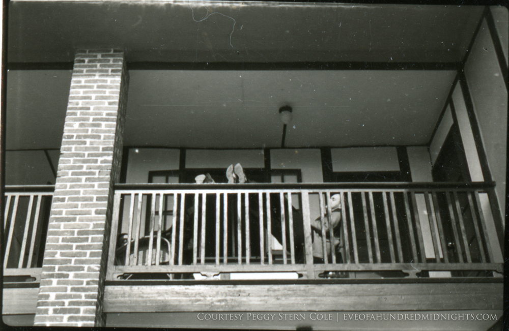 Men sleeping on Press Hostel Balcony.jpg