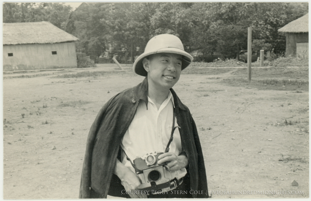 Reporter with camera and helmet to be identified.jpg