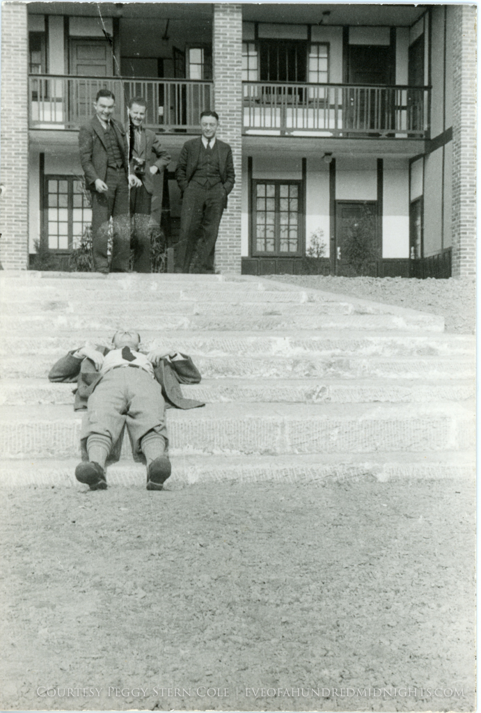 Teddy White Ni nu and dennis Mcavoy laugh at Votaw lying on steps of press hostel.jpg
