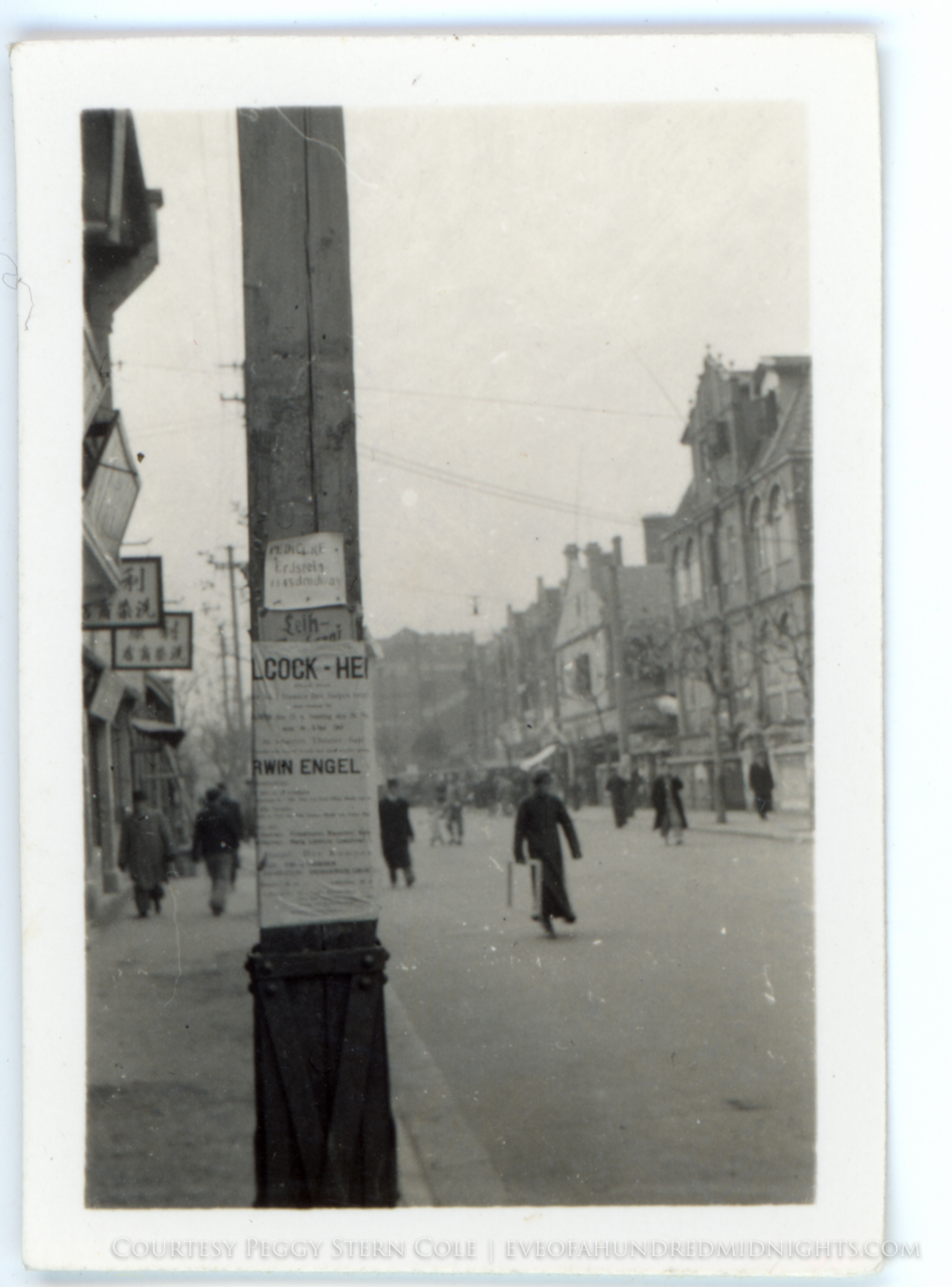 Shanghai Street with Ads on Telephone Pole.jpg