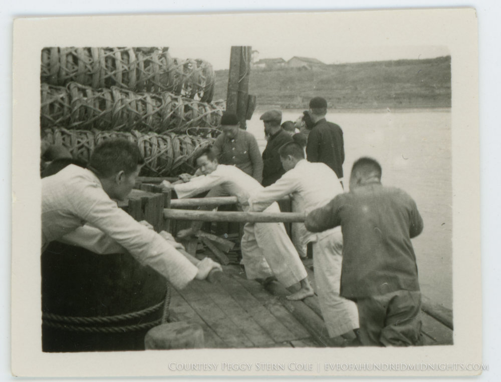 Men pushing wheel on Pearl River Barge.jpg