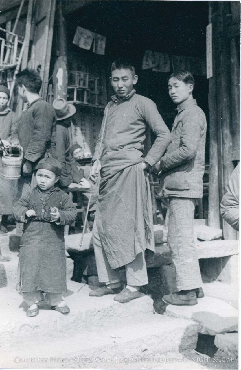 Men and Child in front of shop.jpg