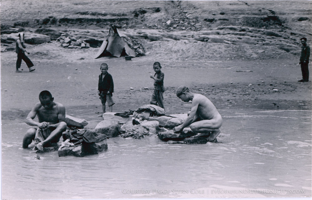Men Naked as they wash clothes in river.jpg