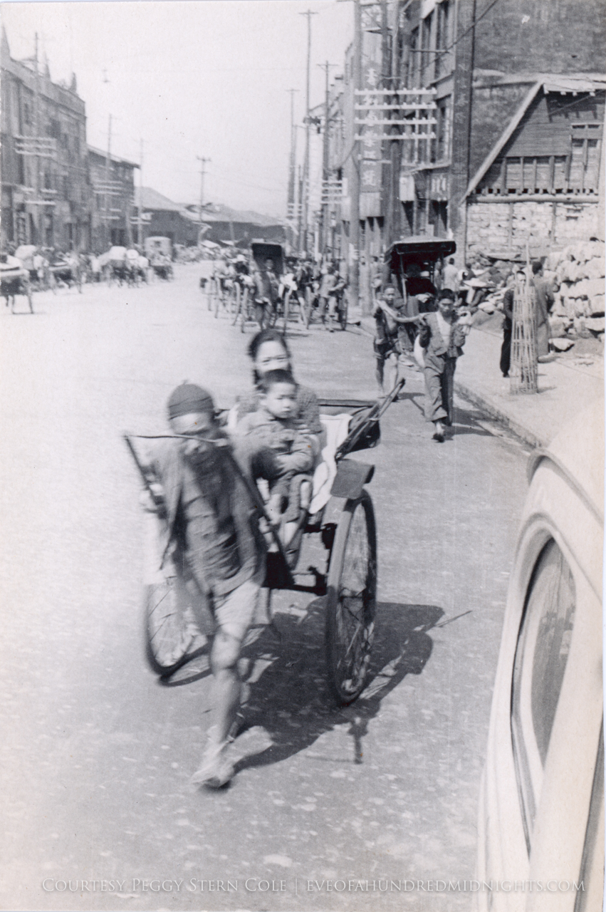 Somewhat blurry rickshaw with woman and child.jpg