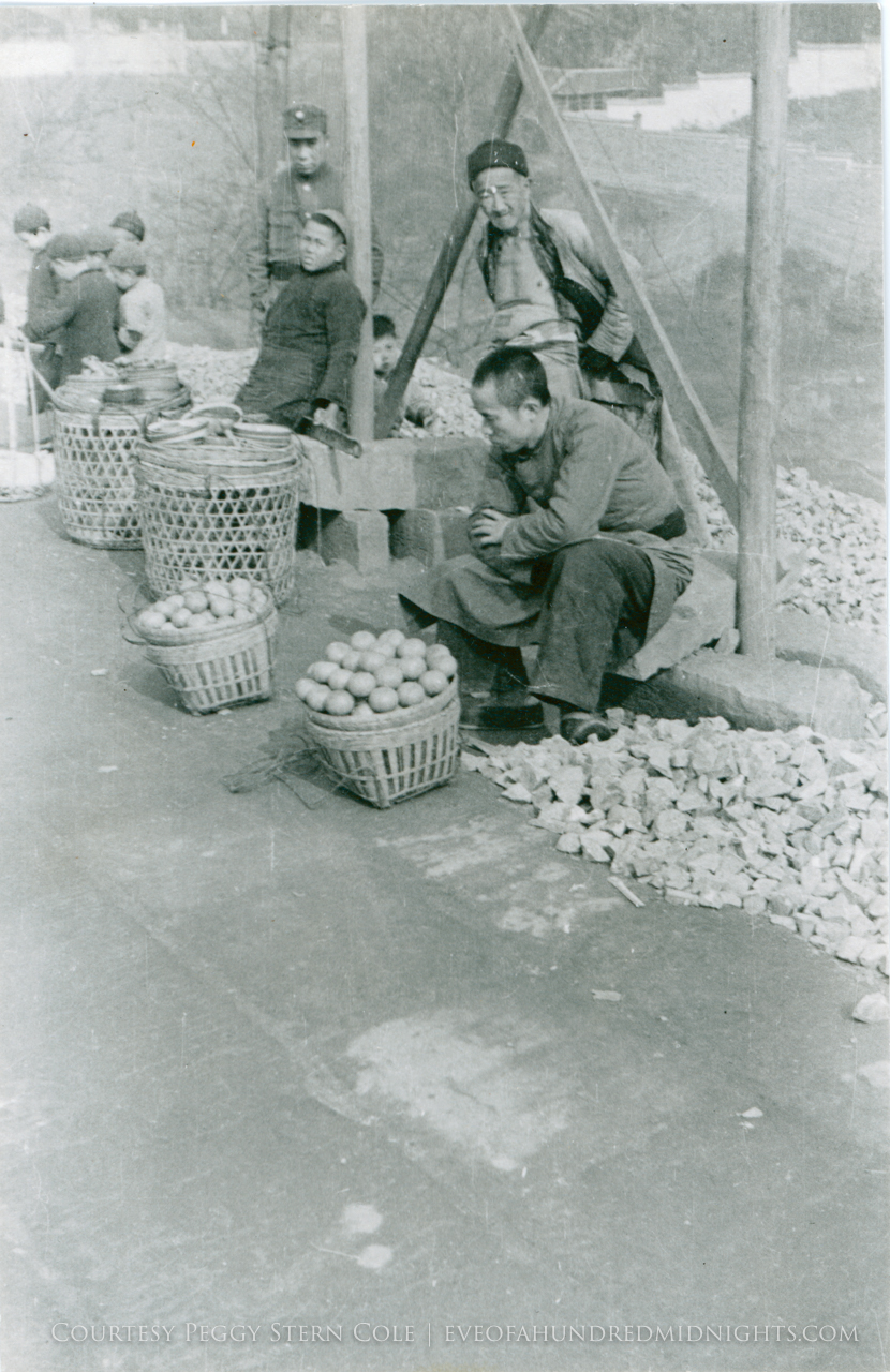 Vendors with fruit baskets.jpg