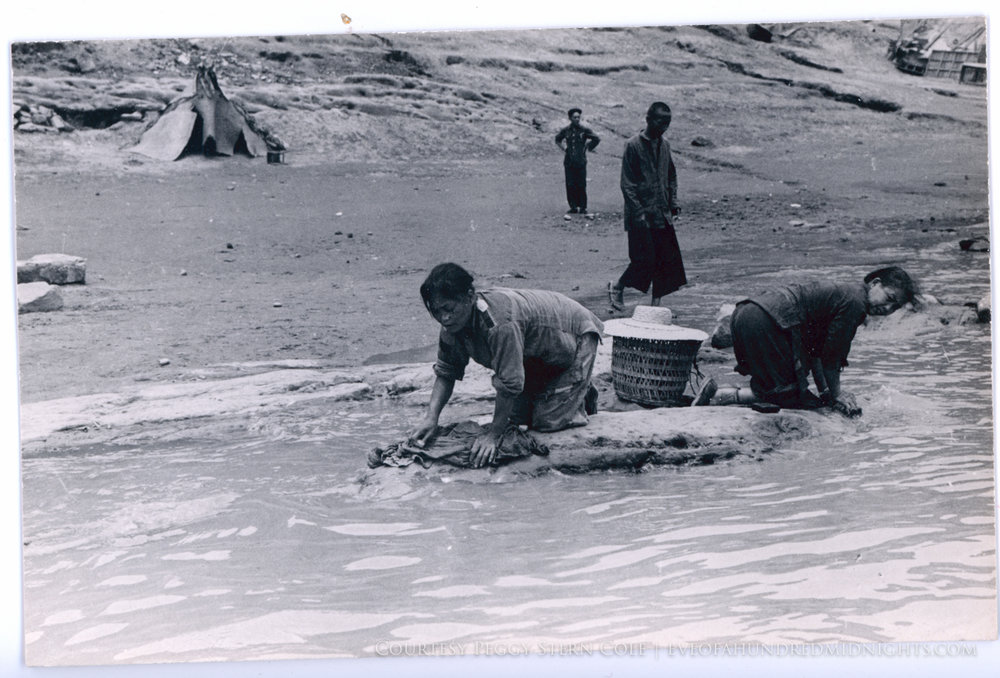 Women washing clothes in river.jpg