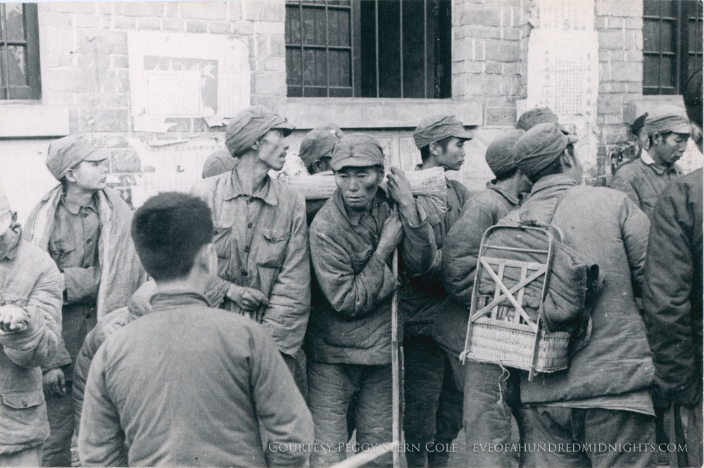 Workers or soldiers in uniform grouped.jpg