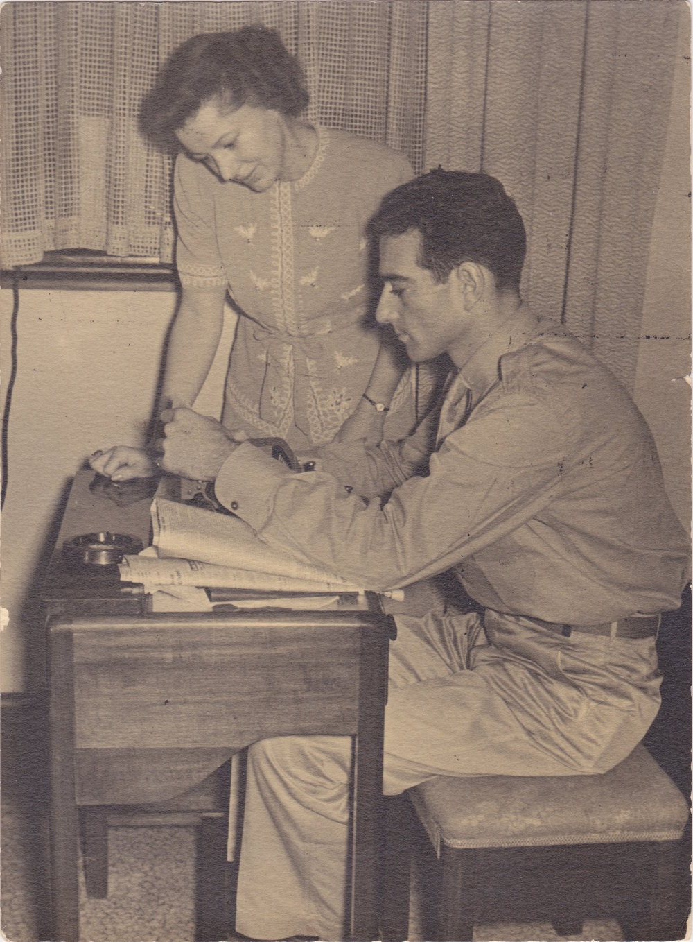 Newlywed reporters Melville and Annalee Jacoby at work together during the outset of World War II.  Photo Courtesy Peggy S. Cole .