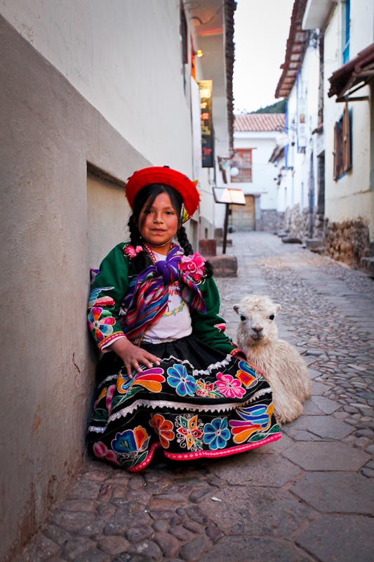 Girl with baby alpaca, Cusco, Peru 2010.