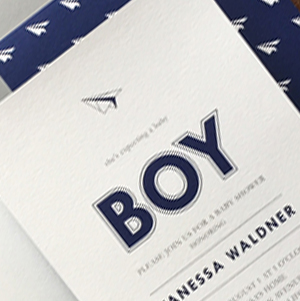 modern paper airplane baby shower invitation in navy blue