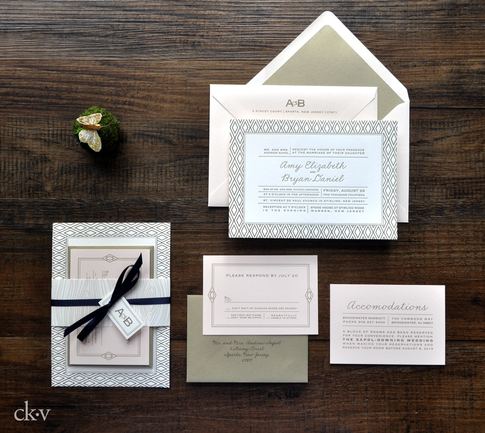 Rustic letterpress wedding invitation suite with faux bois and diamond accents.