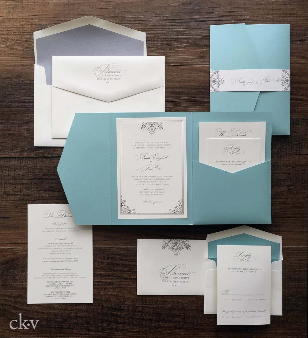 Tiffany blue pocket folder invitation with ornate accents in platinum.