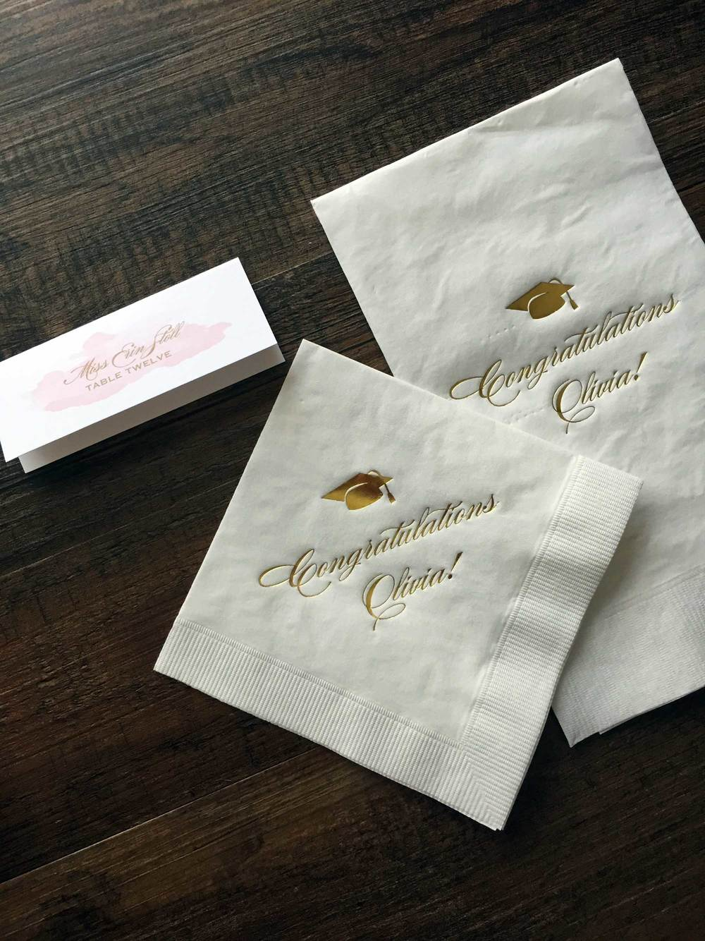 Custom place cards, gold foil cocktail napkins and guests towels.