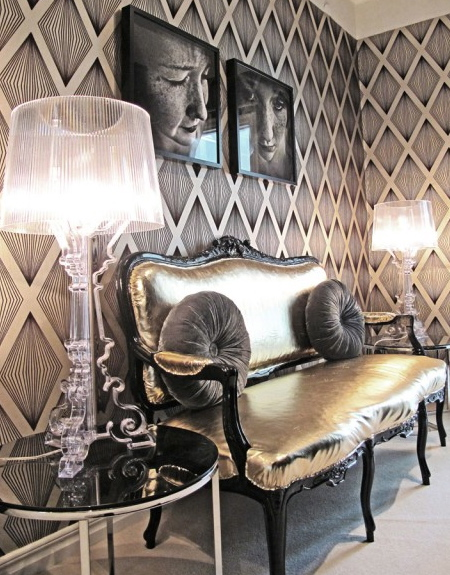 Bold, graphic Wall + Traditional Settee + Metallic Fabric + Acrylic Accents + Photography. These room is fill with contradiction and wonder...