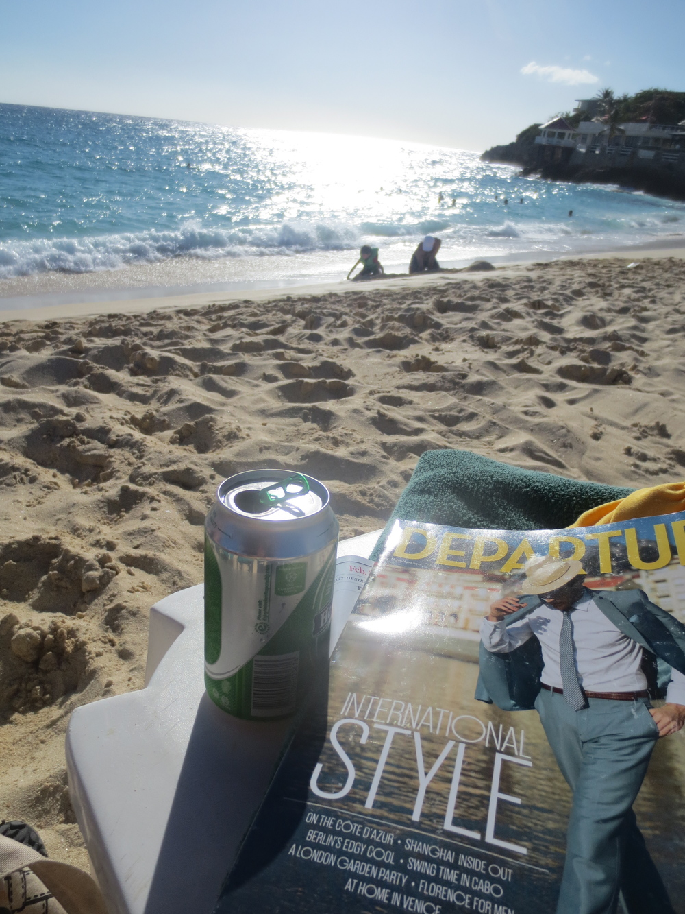 Nothing says paradise quite like a beach, beer, and mag.