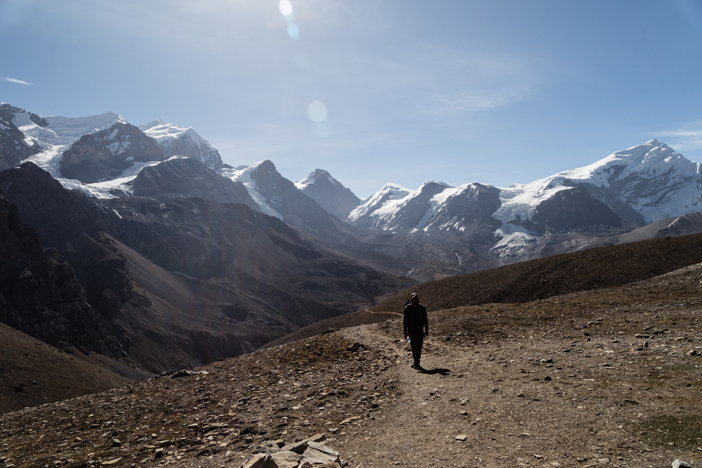 Toby in front of one of the grandest panoramas I'll ever witness. The Purkung Himal range with Chulu west on the right.