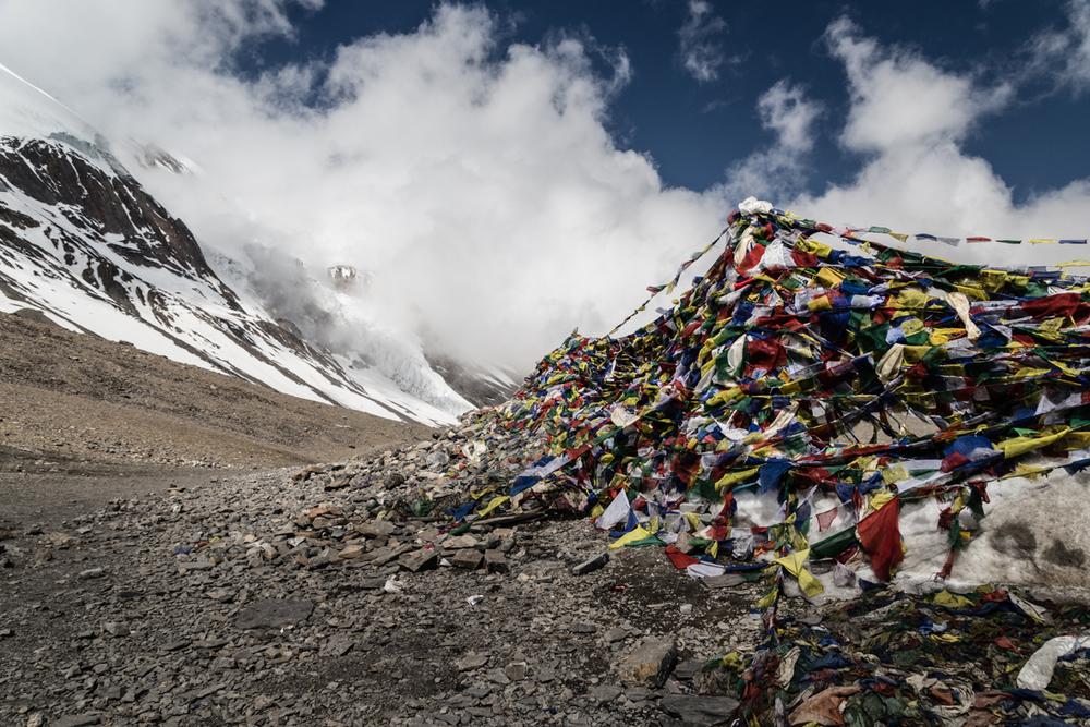 Prayer flags marking the highpoint of ThorungLa high pass.