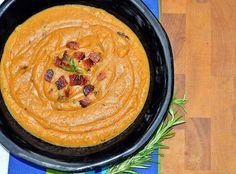 Soup season!   If you have the extra time to make your own broth from chicken bones, you are adding natural immunity boosting properties. Much needed this time of year!  This delicious little treat is a Sweet potato bisque made with homemade chicken bone broth and paleo (no sugar added) chopped bacon bits.   Paleo friendly Sweet Potato Bisque with Bacon   3 large sweet potatoes, peeled and chopped. (totaling 3-3 1/2 pounds) 1 red pepper, halved and seeded (optional) 1 large onion, chopped  1 inch piece of ginger, chopped  1 garlic clove, chopped  6 cups of homemade broth  1 tsp coconut oil 1/4 cup unsweetened coconut milk  1/2 tsp black pepper  Pedersons paleo bacon ( ook as needed)  Sea salt to taste   Directions:   Heat the broth and add the coconut oil. When at rolling boil, add the rest of the ingredients, leaving out the garlic. Simmer for approx 30 minutes. Add the garlic and summer for an additional 10.  You can also roast the sweet potato for a slightly yummier flavor.   When the sweet potato is ready, take the soup off. Let cool about 20 mins. Scoop equal parts of veggies and broth into your blender/vitamin and add 1/4 cup coconut milk. Blend until slightly thick but not chunky. Add sea salt to taste.  Crisp up that bacon and serve steamy!  Enjoy!