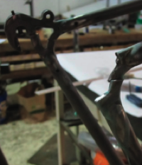 This frame had been ridden from Minneapolis to New Orleans and back loaded with gear, see repaired below!