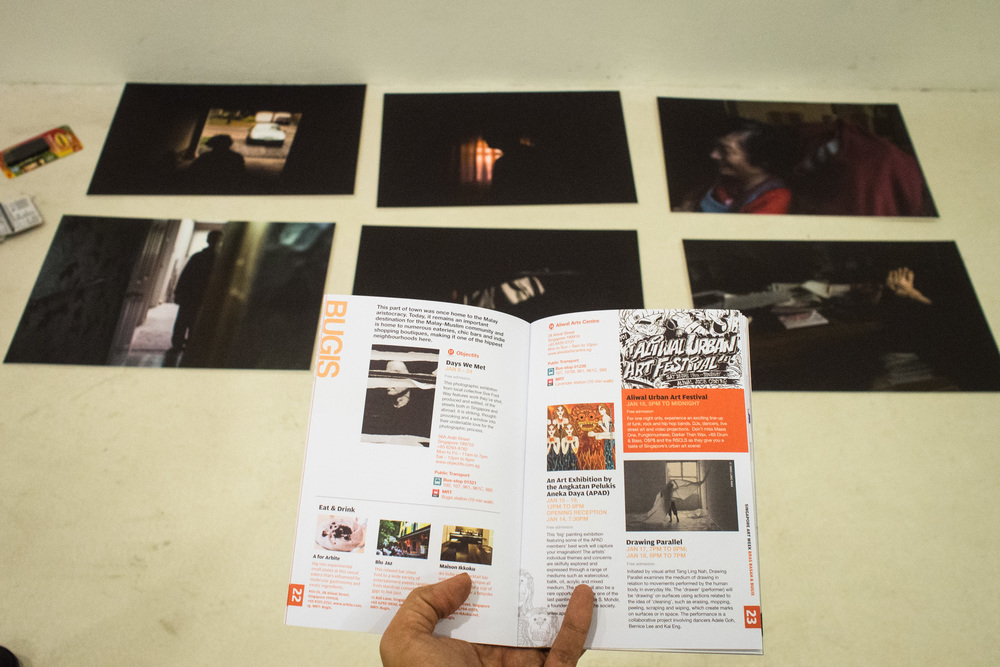 Our exhibition listing in the Singapore Arts Week Guide. In the background are Donna's prints, before they went up on the wall.
